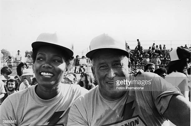 American television actor Lee Chamberlain has her arm around the shoulders of writer Mickey Spillane at the television competition 'Battle Of The...