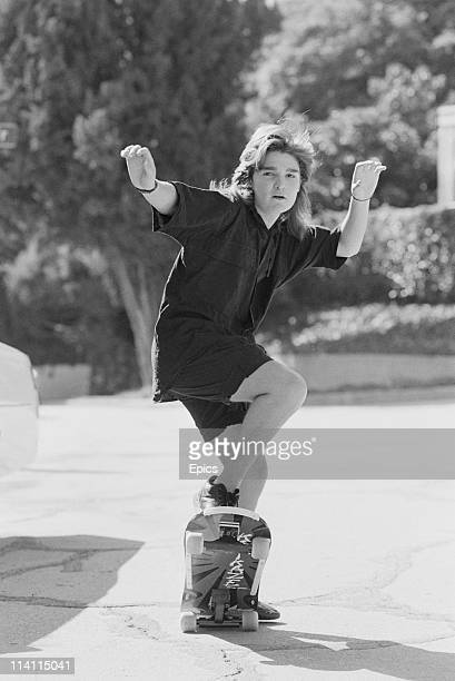 American television and film actor Corey Feldman poses on a skateboard for a magazine shoot United States circa 1985