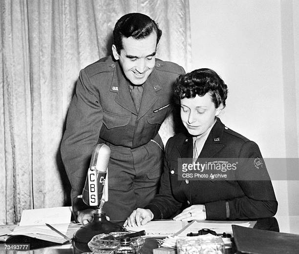 American television and radio journalist Edward R Murrow born Egbert Roscoe Murrow stands behind his wife Janet Huntington Brewster Murrow as she...