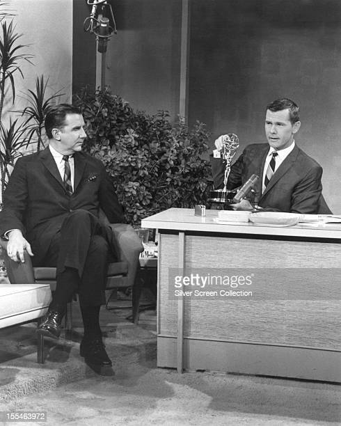 American television host and comedian Johnny Carson with Ed McMahon on his talk show 'The Tonight Show Starring Johnny Carson' circa 1965 He is...