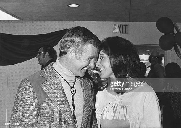 American television host and comedian Johnny Carson with Joanna Holland at a Boomtown Party organized by the SHARE Inc charity circa 1972 The couple...