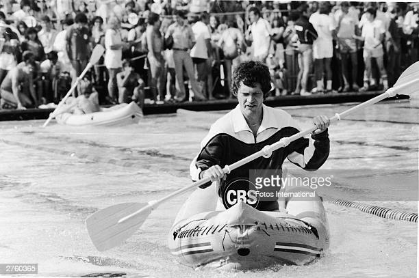 American television host David Letterman competes in a kayak race during the 'Battle of The Network Stars' in Malibu California 1978
