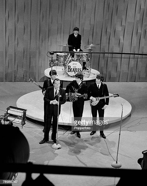 American television host Ed Sullivan introduces The Beatles on their first appearance on 'The Ed Sullivan Show' at CBS Studio 50 in New York City,...
