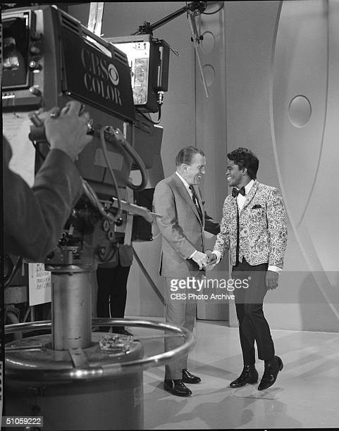 Still from the Ed Sullivan Show shows host Ed Sullivan shaking the hand of musical guest American soul singer James Brown New York October 30 1966 A...