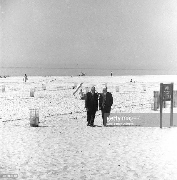 American television journalist and producer Bill Leonard walks on a nearly deserted beach and talks with public official and city planner Robert...
