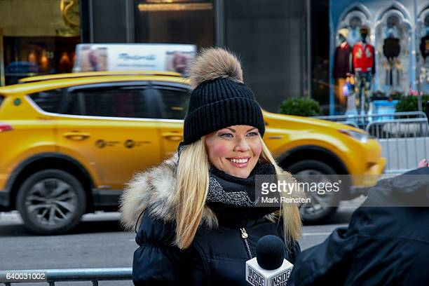 American television journalist Diane McInerney of the show 'Inside Edition' reports across the street from Trump Tower New York New York January 10...