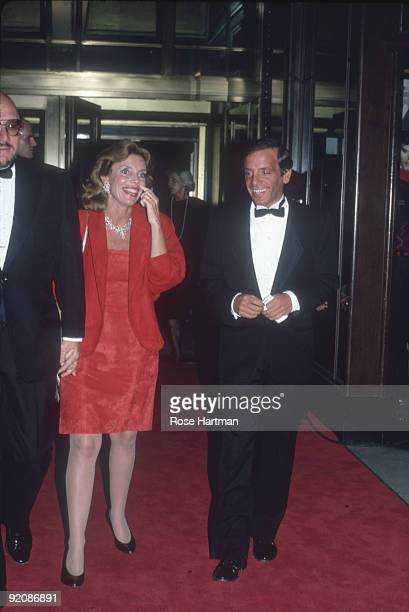 American television personality and former newswoman Judy Licht walks with her hsband advertising executive Jerry Della Femina and businessman and...