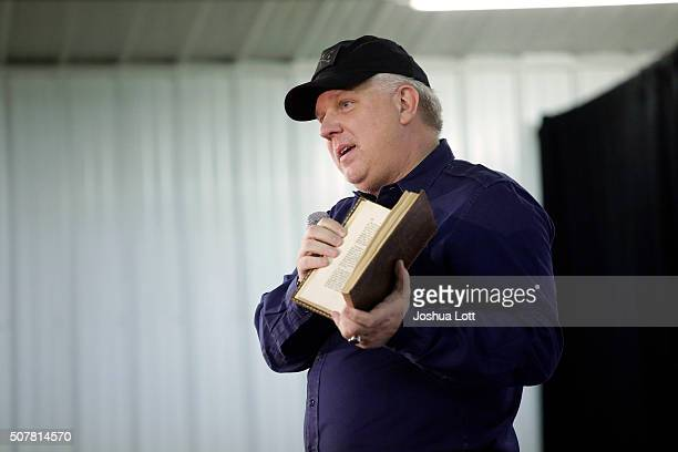 American television personality and radio host Glenn Beck holds a copy of a Don Quixote book as he talks about Republican presidential candidate Ted...