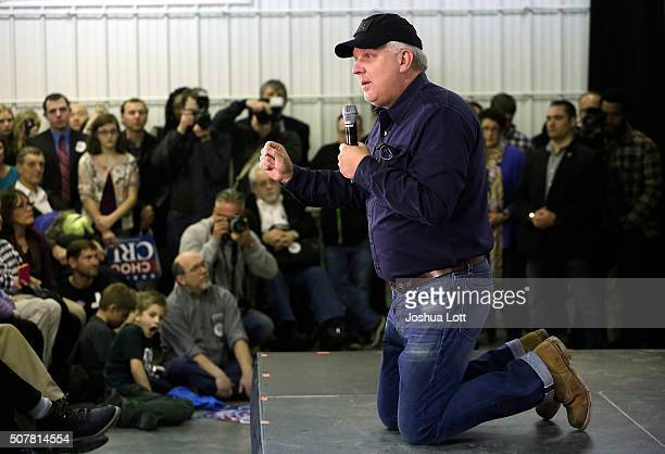 American television personality and radio host Glenn Beck talks from his knees about Republican presidential candidate Ted Cruz during a campaign...