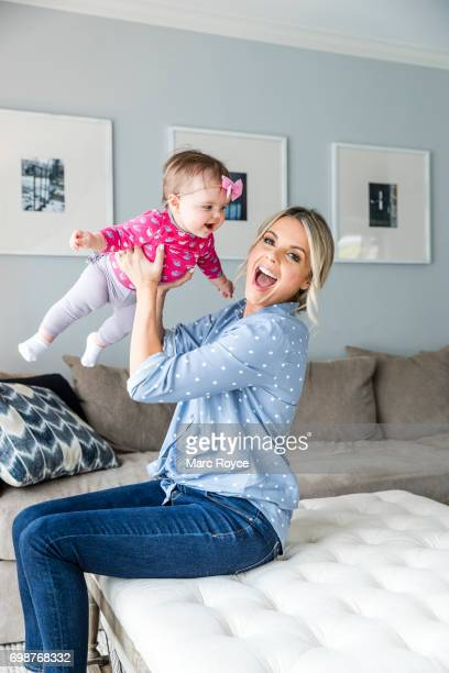 American television personality correspondent host spokesperson and blogger Ali Fedotowsky is photographed with her family for Us Weekly on February...