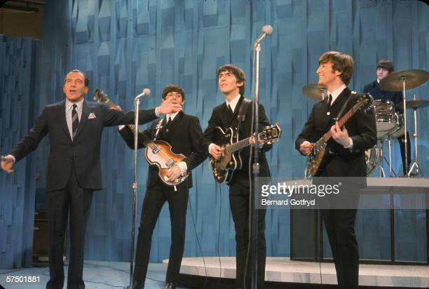 American television personality Ed Sullivan introduces British pop and rock music group the Beatles on his tv variety program 'The Ed Sullivan Show'...
