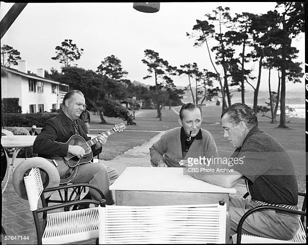 American television personality Ed Sullivan sits at an outdoor table and interviews American singer and actor Bing Crosby for the CBS Television...
