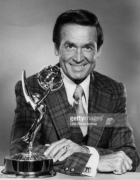 American television personality game show host and animal rights activist Bob Barker leans on a counter with an Emmy statuette in a promotional...