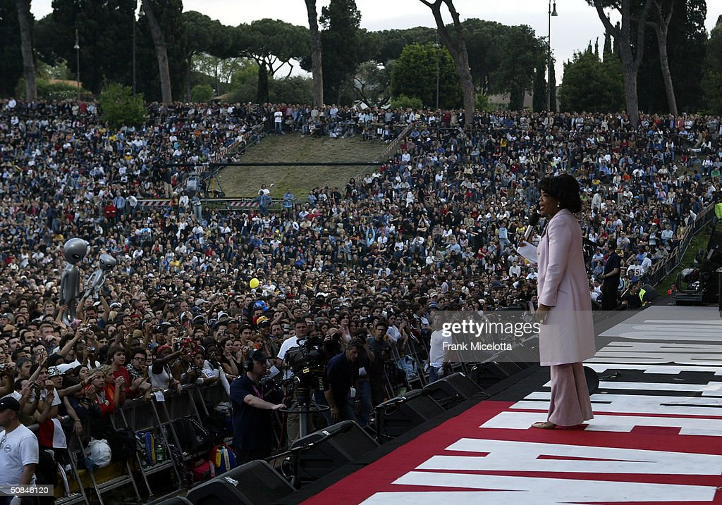 American television personality Oprah Winfrey on stage at the 'We are the Future' all-star humanitarian concert May 16, 2004 at Circus Maximus in Rome, Italy. The show will be is being broadcast globally on MTV and will raise money to open child centers in the most war torn regions of the world.