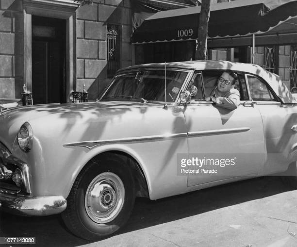 American television personality Steve Allen driving his Packard automobile, circa 1952.