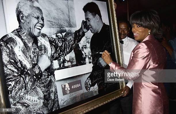 American television presenter Oprah Winfrey attends a gala dinner held at the Vergelegen Estate outside Cape Town prior to the Give 1 Minute to AIDS...