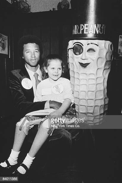 American tennis champion Arthur Ashe with Kristin Behrman New York State's Easter Seal Child 15th March 1977 The Easter Seals agency provides support...