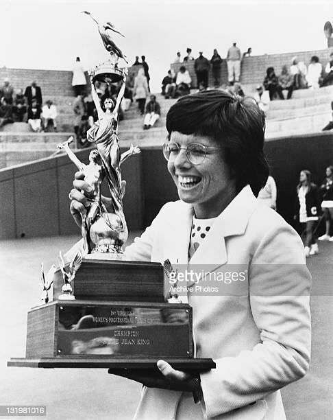 American tennis champion Billie Jean King holding the trophy for the Virginia Slims Women's Professional Tennis Circuit circa 1970