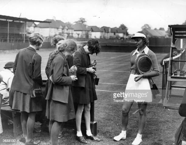 American tennis player Alice Marble poses for fans' photographs at the Surrey championships' Ladies semifinals Original Publication People Disc HH0162