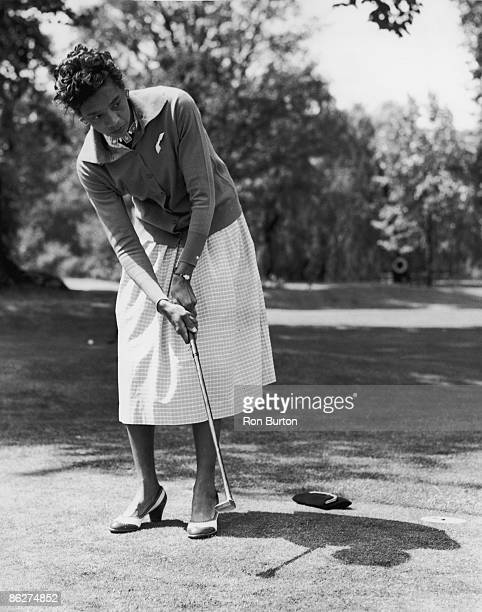 American tennis player Althea Gibson enjoys a round of golf at the reception for overseas entrants in the Wimbledon Lawn Tennis Championships held at...