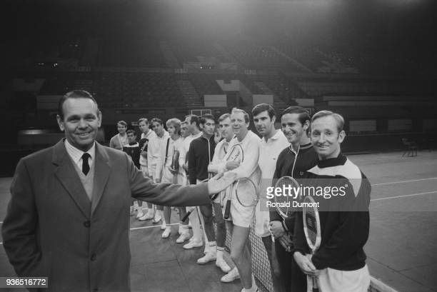American tennis player and coach Jack Kramer with professional tennis players at the Empire Pool London UK 15th November 1968 Cliff Drysdale Ken...