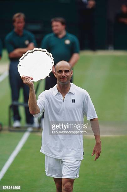 American tennis player Andre Agassi pictured holding the runner's up dish after being defeated by Pete Sampras in the final of the Men's Singles...