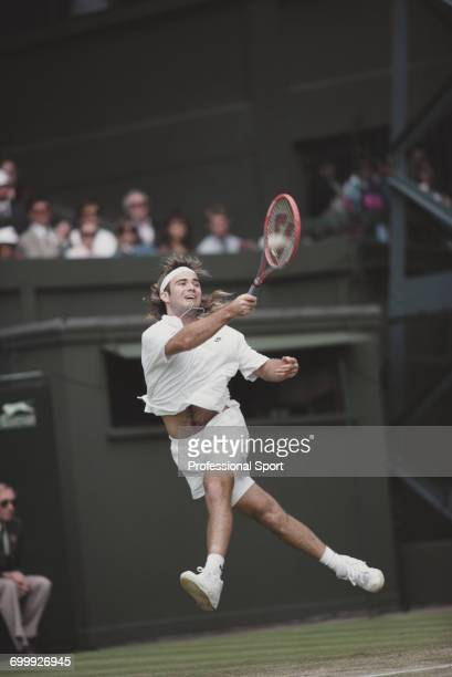 American tennis player Andre Agassi pictured in action competing to progress to reach the quarterfinals of the Men's Singles tournament at the...