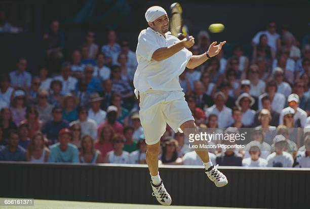 American tennis player Andre Agassi pictured in action during competition to reach the semifinals of the Men's Singles tournament at the Wimbledon...