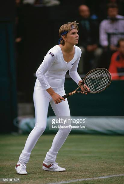 American tennis player Anne White pictured wearing a white body suit during action against Pam Shriver in the first round of the Women's Singles...