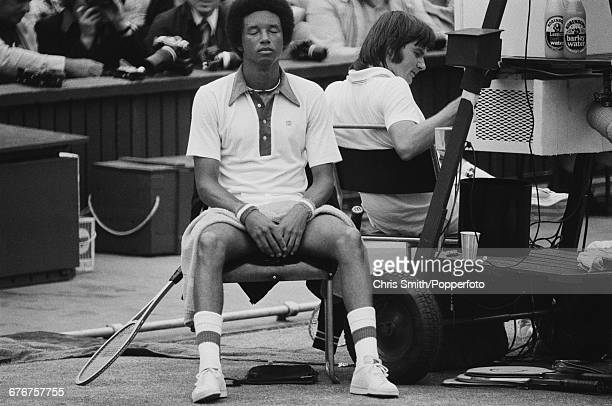 American tennis player Arthur Ashe pictured left at rest during a break in action during competition to win the final of the Men's Singles tournament...