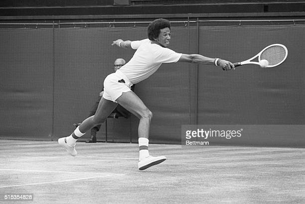 American tennis player Arthur Ashe grimaces as he hits a backhand return to American Jimmy Connors during their 7/5 men's singles title match at...