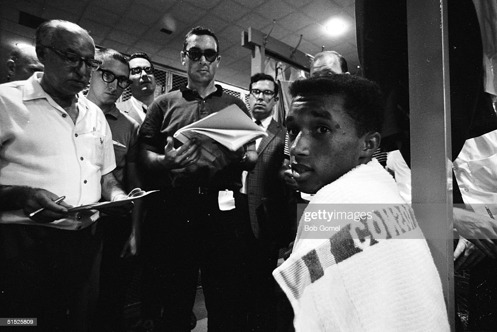 American tennis player Arthur Ashe (1943 - 1993) (right) is interviewed by reporters at the US National Championships, Forest Hills, Queens, New York, September 1965.