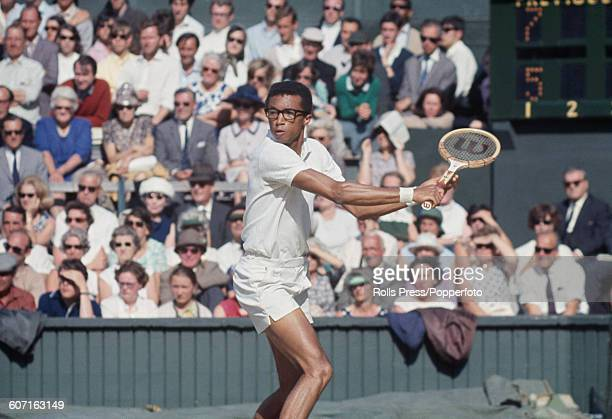 American tennis player Arthur Ashe pictured in action during his semi final match against Rod Laver of Australia at The Championships, Wimbledon...
