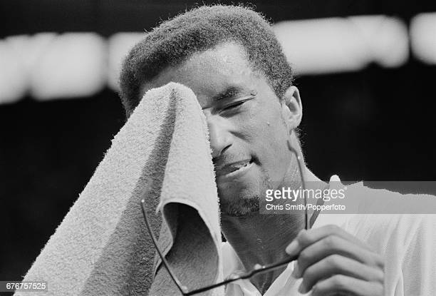 American tennis player Arthur Ashe pictured wiping his forehead with a towel during competition to win his fourth round match against fellow American...