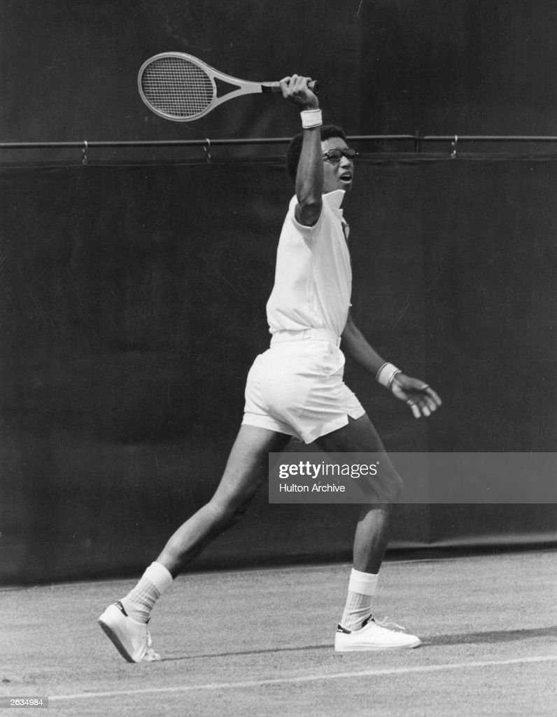 American tennis player Arthur Ashe (1943 - 1993 ) playing at Wimbledon in the All England Tennis Championships. Original Publication: People Disc - HG0108