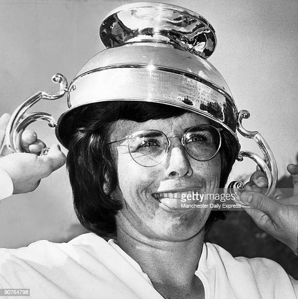 American tennis player Billie Jean King clowns with the trophy. A contemporary report ran: �Billie-Jean King, as usual, beat her doubles partner...