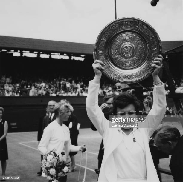American tennis player Billie Jean King holds up the trophy after winning the Ladies' Singles final at Wimbledon London 6th July 1967 She beat Ann...