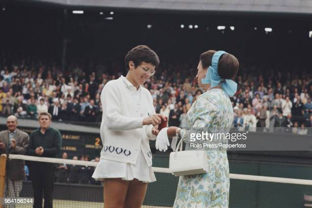 American tennis player Billie Jean King is presented with the runner's up medal by Princess Margaret, Countess of Snowdon after being defeated by...