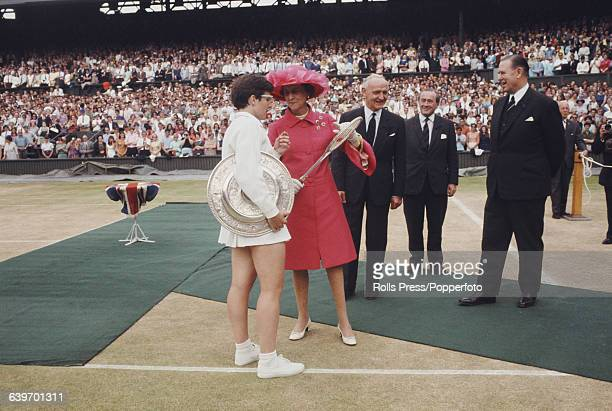 American tennis player Billie Jean King is presented with the Venus Rosewater Dish trophy by Princess Marina of Kent after winning the ladies'...
