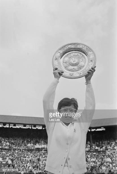American tennis player Billie Jean King parades her trophy after winning Women's Singles during Wimbledon Championships defeating Australian tennis...