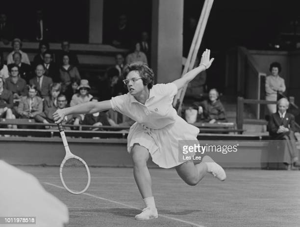 American tennis player Billie Jean King pictured in action against British tennis player Deidre Catt in the 1964 Wightman Cup tennis competition at...