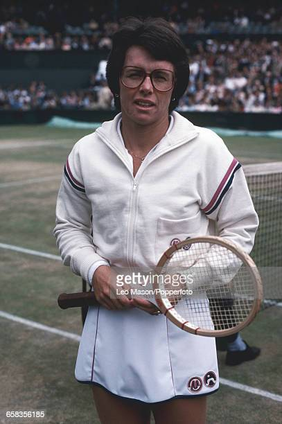 American tennis player Billie Jean King posed beside the court during competition to progress to reach the quarterfinals of the Ladies' Singles...