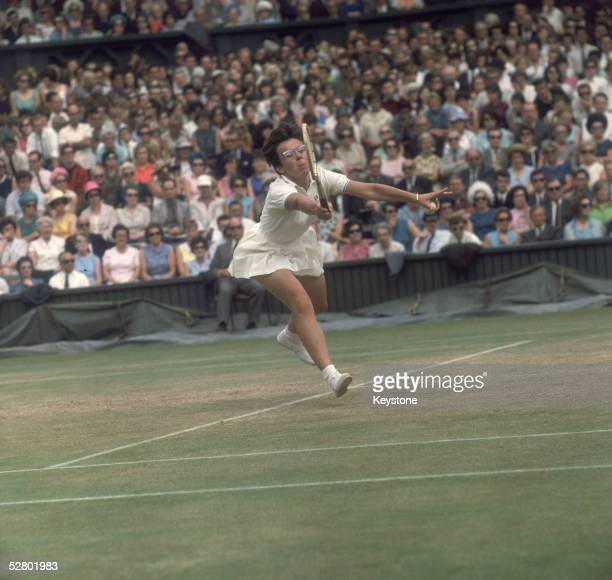 American tennis player Billie Jean King stretches to make a shot during her serve in a game during the Wimbledon Lawn Tennis Championships 1967