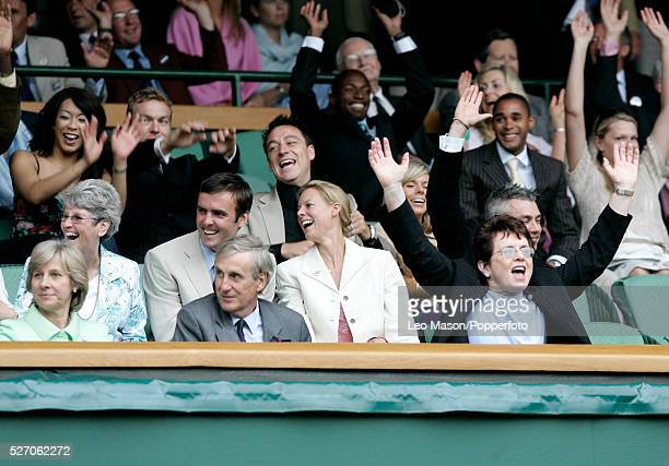 American tennis player Billie Jean King takes part in a mexican wave celebration as she attends the Wimbledon Lawn Tennis Championships at the All...