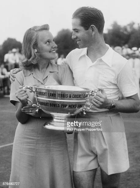 American tennis player Bobby Riggs pictured holding the Victors cup with his wife after defending his title at the annual Seabright Tennis Tournament...