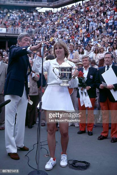 American tennis player Chris Evert holds the US OpenTrophy as she prepares to speak in to a microphone after defeating Pam Shriver 75 64 in the final...