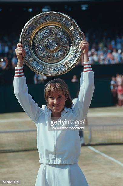 American tennis player Chris Evert pictured raising the Venus Rosewater Dish trophy in the air after defeating Evonne Goolagong Cawley to win the...