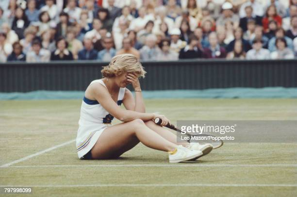 American tennis player Chris Evert pictured sitting on the court with her head in her hand during competition to progress to reach the semifinals of...