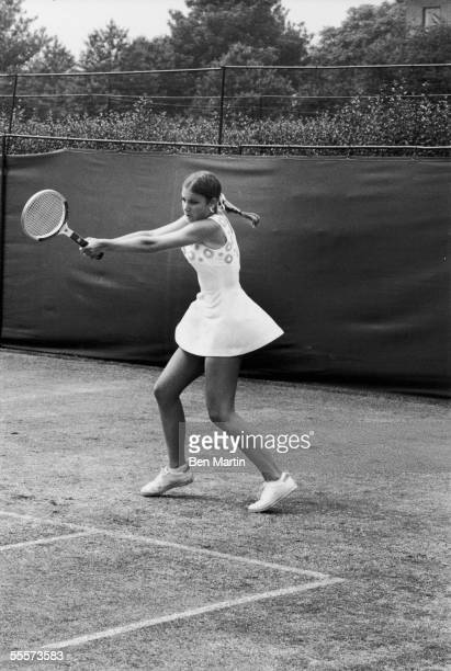 American tennis player Chris Evert swings her racquet during a match against Australian Evonne Goolagong during the Championship at Wimbledon London...
