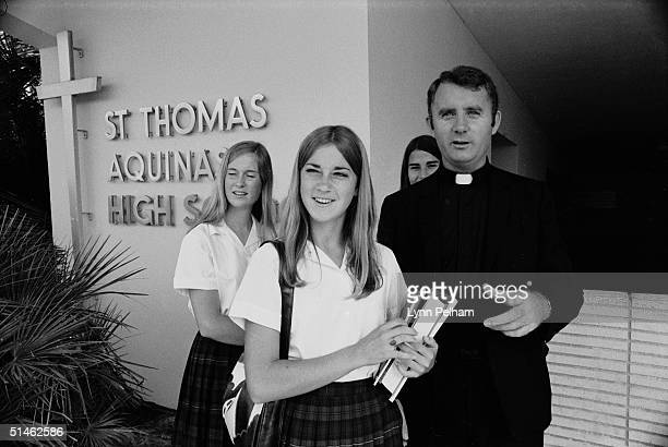 American tennis player Chris Evert walks with principal Father Vincent Kelly and friends at St Thomas Aquinas High School following her impressive...